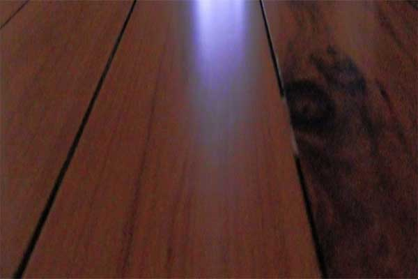 Gaps between polished floorboards