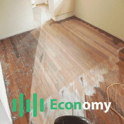 Abrasive angle sanding a floor