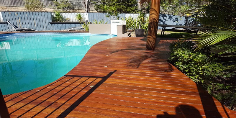Outdoor deck sanding finished with deck oiling around pool