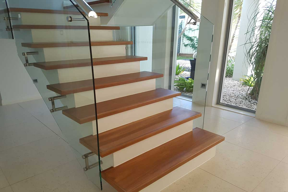 Timber staircase with white uprights