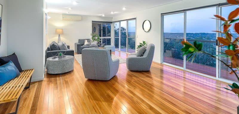 A polished timber floor with lounge furniture on the surface