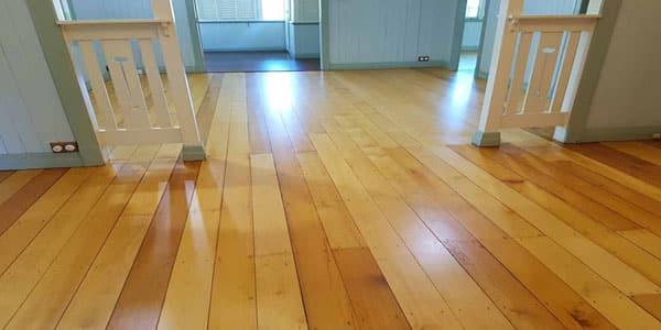 Floor refinishing in oil based coating in a renovated home