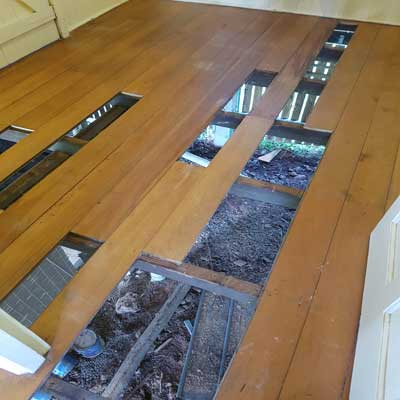 A timber Floor being restored with some floorboards removed