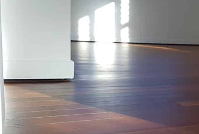 A timber floor refinishing example showing defects.
