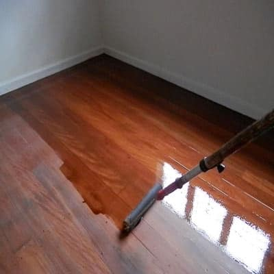 Coating a timber floor with finishes