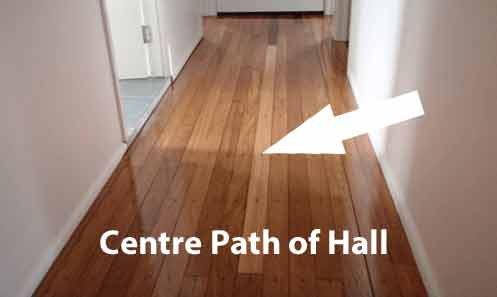 Wear on polished wooden hallway