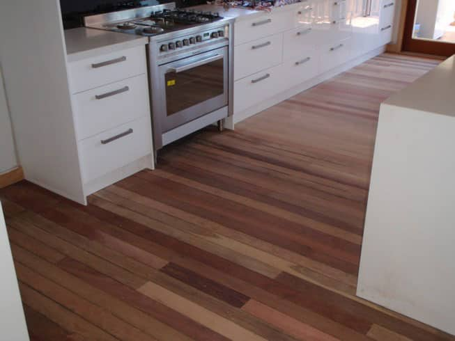 A sanded kitchen floor ready for polish.